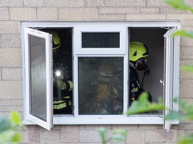Firefighters work through the building to ensure there are no pockets of fire left
